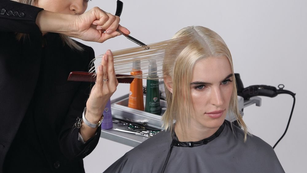 STEP 7: Beginning at the section above the ear and moving toward the face, take vertical sections held straight out and create vertical deep texture with your razor. The amount oftexture will depend on the density of the hair. Repeat on the opposite side.