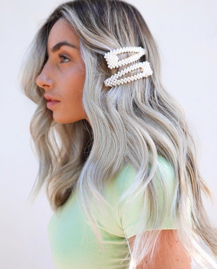 Clips are the perfect accessory for keeping hair from hiding your client's beautiful eyes! Look by @themaneartistry.