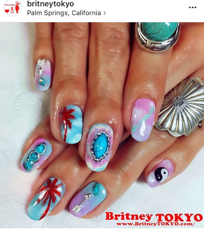 <p>Via @britneytokyo. Britney Tokyo didn't mess around with this Coachella-inspired manicure, complete with cotton-candy skies and jeweled adornments.</p>