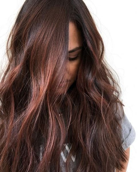 This red-ish brunette shows that you can offer your clients a variety of dimensions and color options aside from a traditional brunette look.