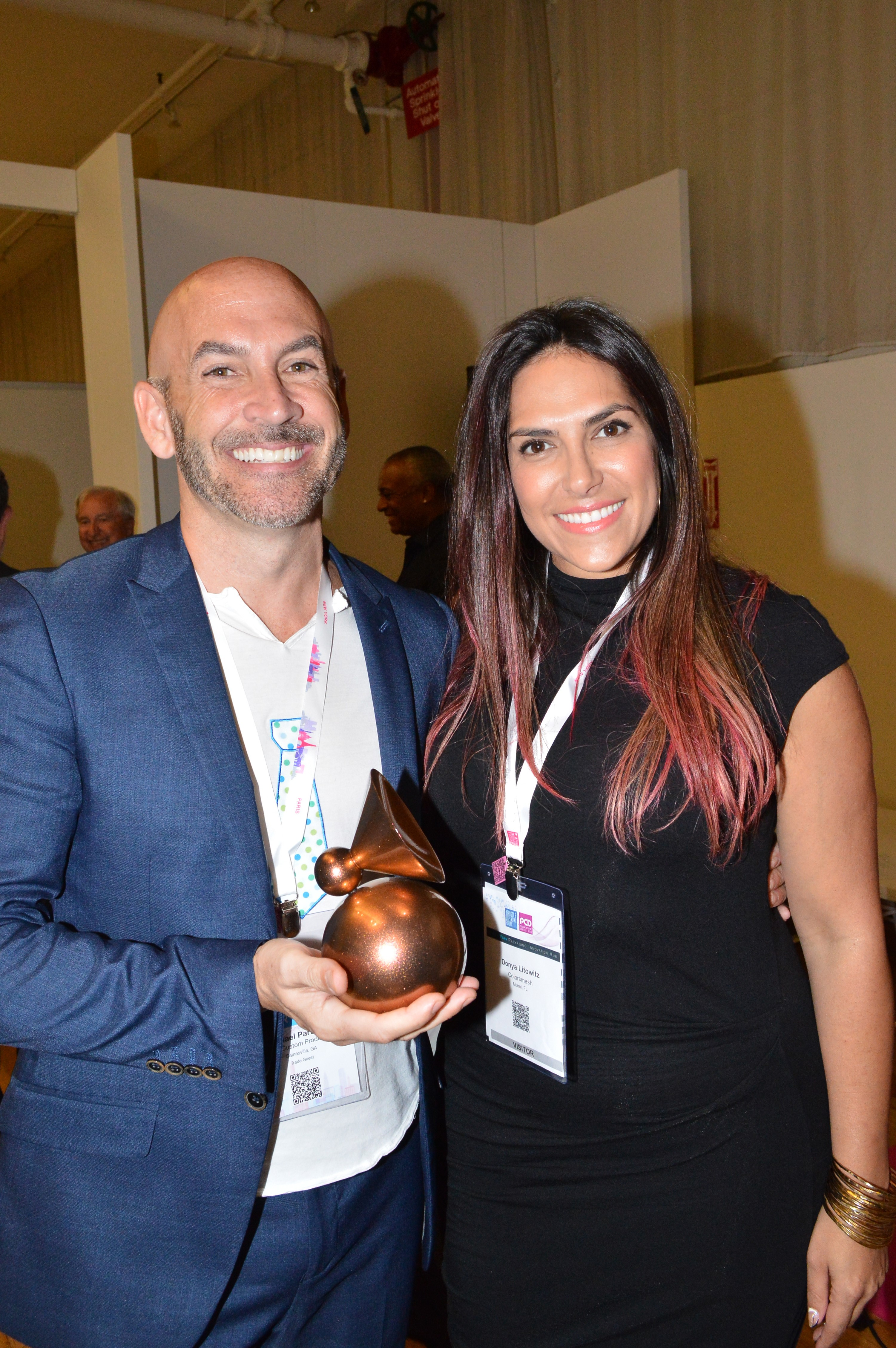 Michael Partridge, executive partner of Healthy Dyeit, and Donya Litowitz, CEO, celebrate Colorsmash's win of the first US ADF&PCD New York Packaging Innovation Award for hair care/haircolor.
