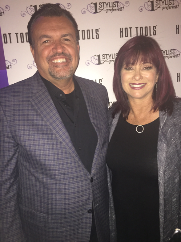 <p><em>Hot Tools took over Hard Candy Lounge at Mandalay Bay to celebrate their Hairdresser Hall of Fame.  They inducted some of their favorite stylists into this prestigious group, including their own Vice President of Marketing Terri Taricco (left) who took a moment for a photo opp with Hot Tools Scott Hagstrom.</em></p>