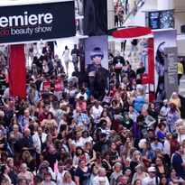 Attendees wait to enter the show floor in 2017.
