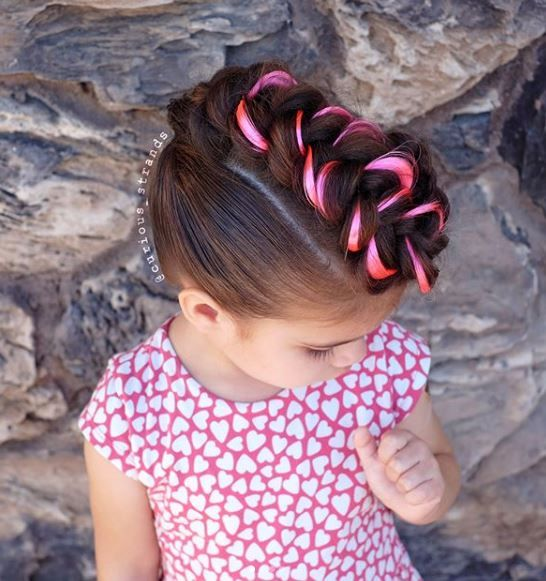 Just like a 24 pack of crayons, the option to explore temporary color or a pink extension (like @curious_strands used here) will delight your kiddo clientele with endless color possibilities.