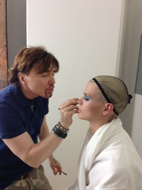 David Maderich touches up the make up