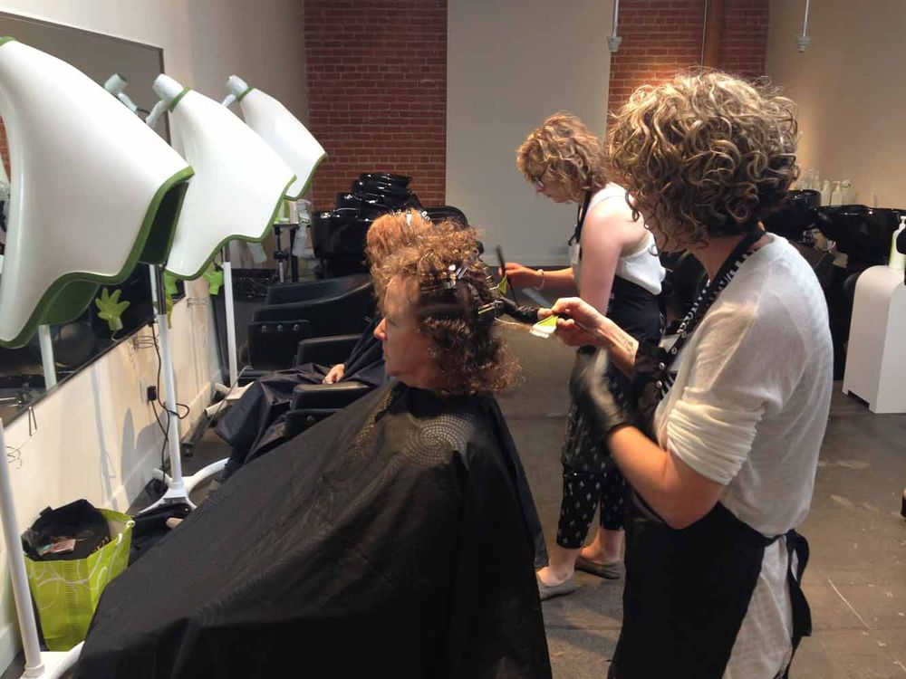 ACADEMY: Curly-haired students concentrate on their curly-haired clients.