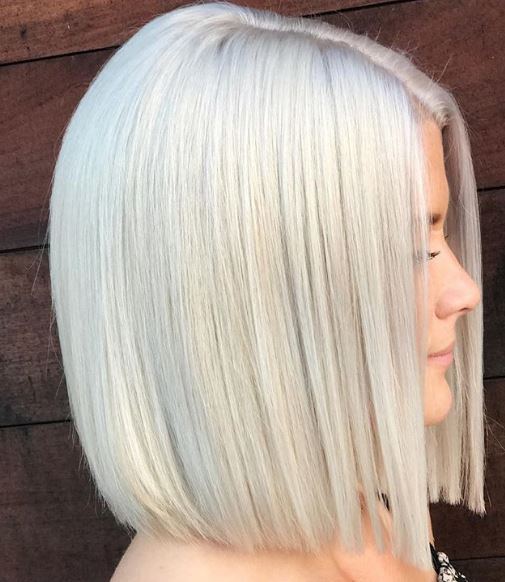 Smooth operator! This platinum lob has every piece of hair in place to become a jaw-dropping stunner.