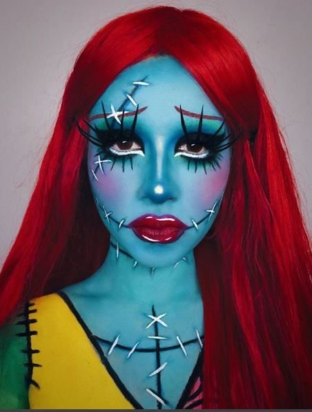 Why so sad? This makeup is taken beyond the face and really amplifies the artistry.