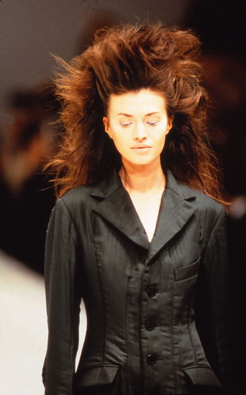 John Sahag's Windswept hair, no style styles with exaggerated volume on the runway for Issey Miyake's Fall 1997 Paris Fashion Week Show.
