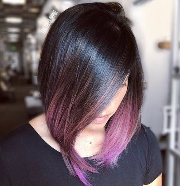 The way this lob has been blow dried in a rounded shape helps amplify the beautiful purple ends. It's a lob with tons of spunk.