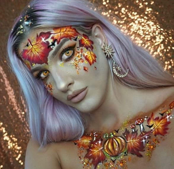 Autumn leaves, please! This goddess of fall is stunning to all.