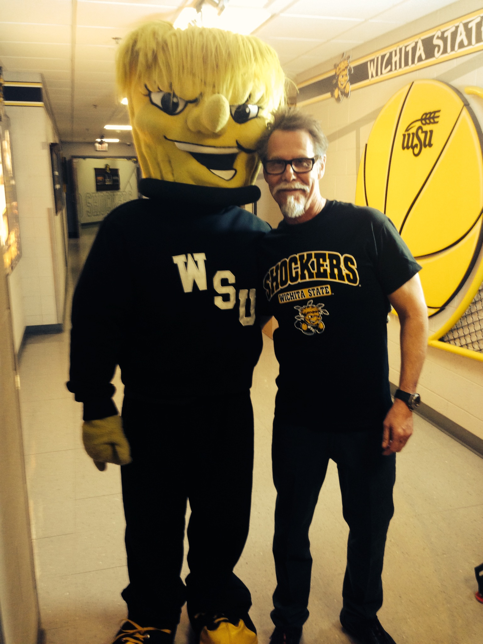 Sports fan Eric Fisher with WuShock, the mascot for Wichita State University.