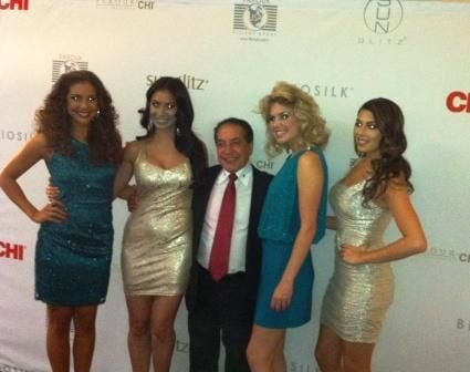 Farouk Shami surrounded by Farouk models