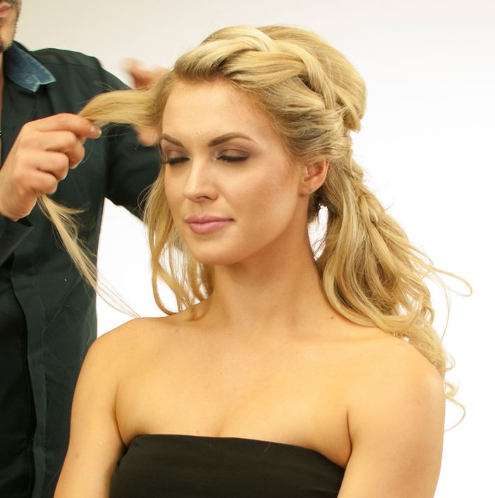 <p>Braid the other side with 2 strands and attach this twist to the ponytail in the nape area.</p> <p>Spray some Royal Treatment Ultimate Control Hairspray to make a firm foundation.</p>