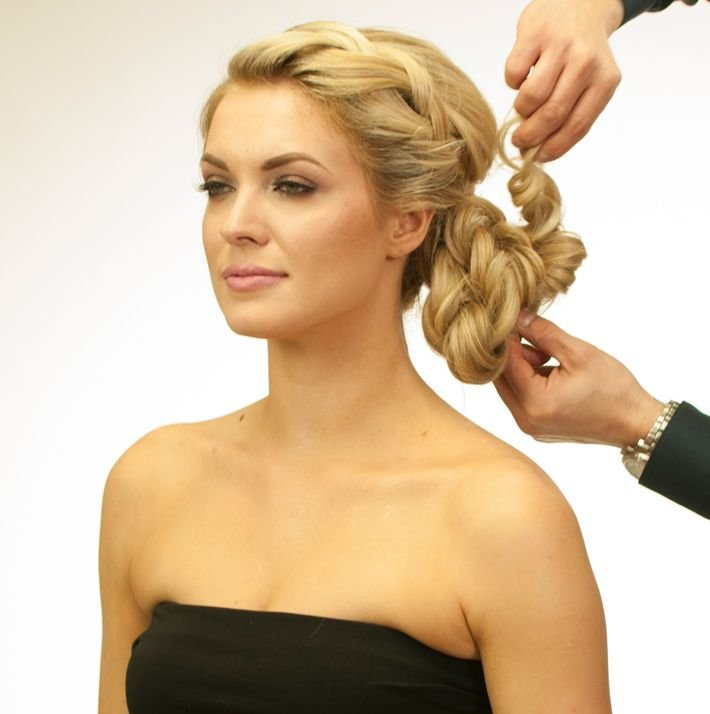 <p>Pin the twisted strands up to the ponytail and finish the look with Royal Treatment Ultimate Control.</p>