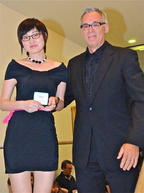 Dominic Bertani presenting the Dominic Michael Silver Scissors Award to a graduating Senior Design student.
