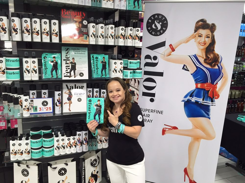 Fearless Pin-Up Katie Meade poses with Fearless Hair Rescue Treatement at the launch of Beauty & Pin-Ups products at Ricky's NYC.