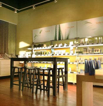 """""""It is impossible to miss the retail area, which is brightly lit from under the shelves. It helps highlight not only the product, but also the eye-pleasing mix of straight and curved lines in the design of the salon. This creates visual interest and maintains balance in the design. It also makes it hard to resist picking up a product."""""""