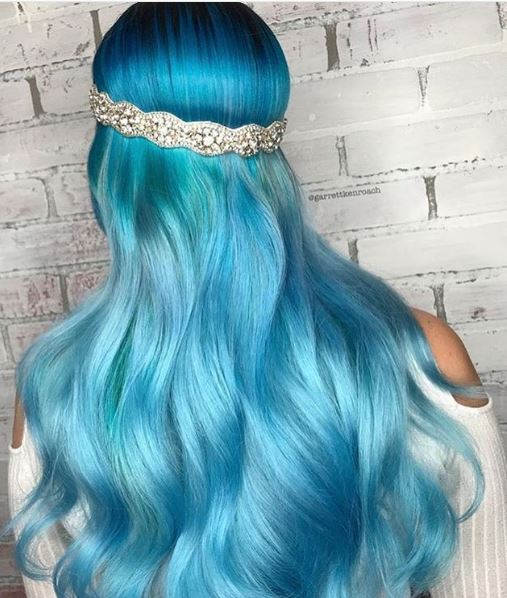 We love the combination of blues used here to give these long locks some depth.