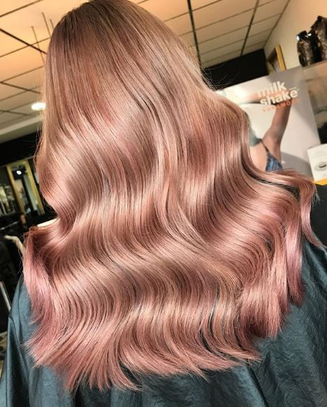 Johnson captures the rose gold hair color trend with this look.