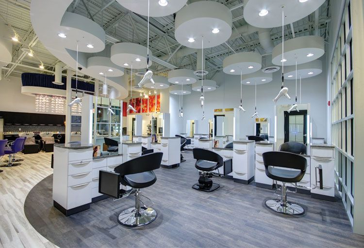 Soft curving floor and ceiling soffit patterns guide traffic flow while paying tribute to the salon's Yin and Yang theme.
