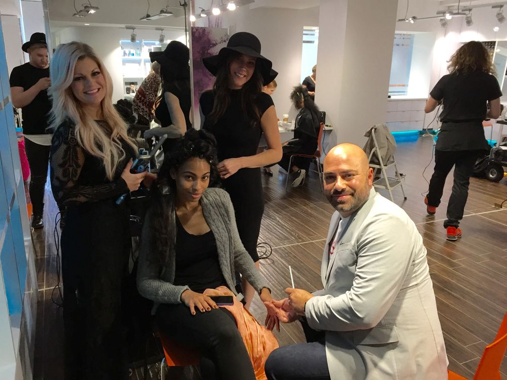 essie's Gino Trunzo puts the finishing touches on Jayme Mees's model