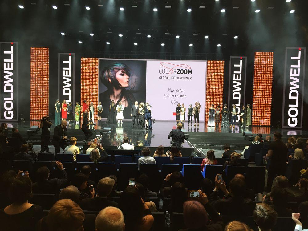 Mio Sota accepts her award from John Moroney.