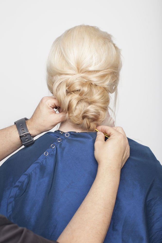 Fold ponytail up underneath the section above and secure with a stitch. This gives volume to the back. Finish with a little hairspray and spray wax to keep it loose looking.