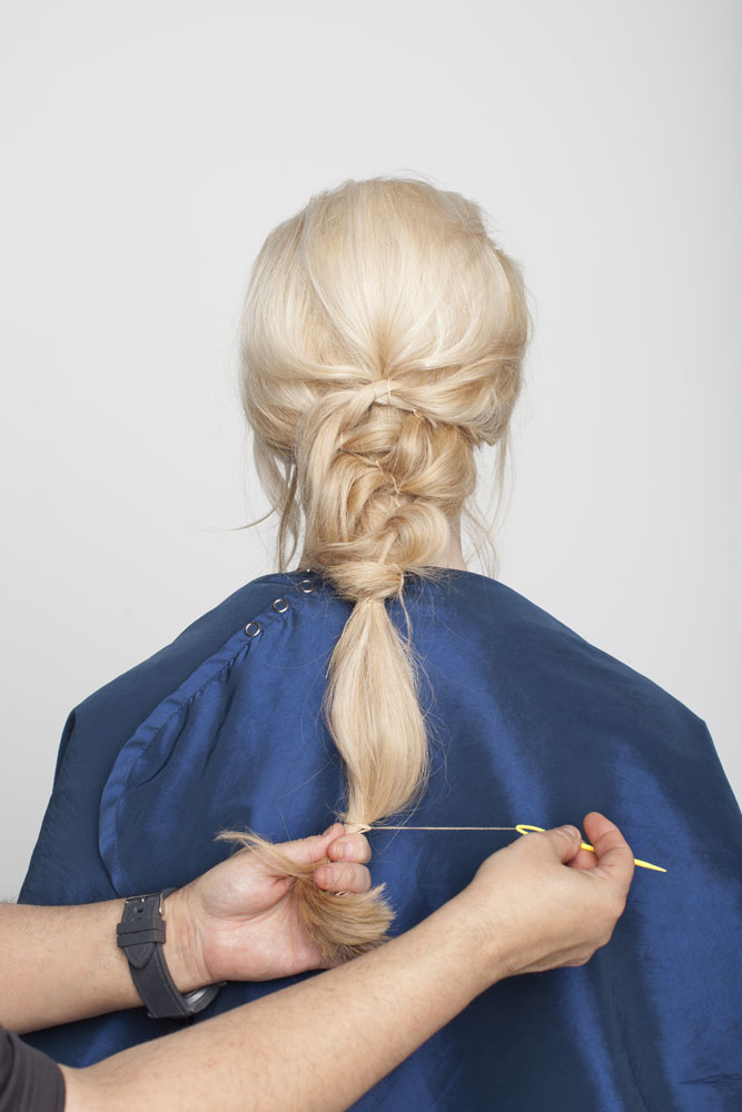 Secure the bottom of the ponytail with remaining thread.