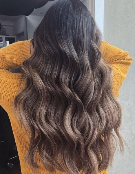 The combination of caramel and brunette here becomes the trendy bronde shade many clients are craving.