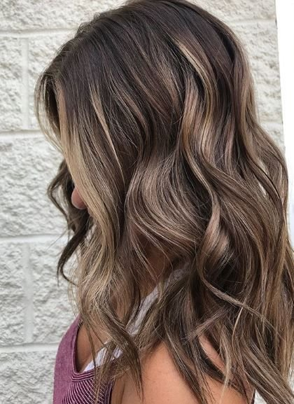 This hair reminds us of days at the beach yet still makes us feel cozy for fall. It's an excellent example of how to help clients transition for autumn.