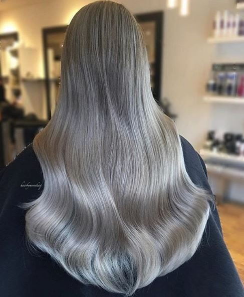 @hairbymonika.q kills it EVERY #modernsalon color contest! We're obsessed with this color and those waves, all of which were created using @schwarzkopfusa @oligopro and @brazilianbondbuilder.