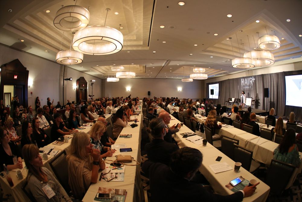 A packed house of salon professionals and category experts attended this year's HAIR+ Summit. Here they sit in on the Hair Loss 101 presentation by <strong>Dr. Nikki Hill.</strong>