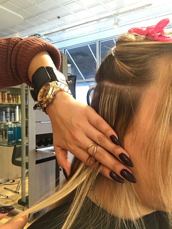 Iannone smoothes the natural hair over the extension.