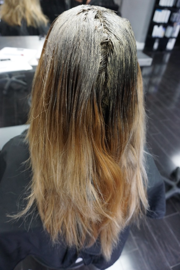Using Paul Mitchell The Color 2NN + 20 vol - we re-deposited a deeper color to her base and brought it about 4 inches down to her mid-shaft.