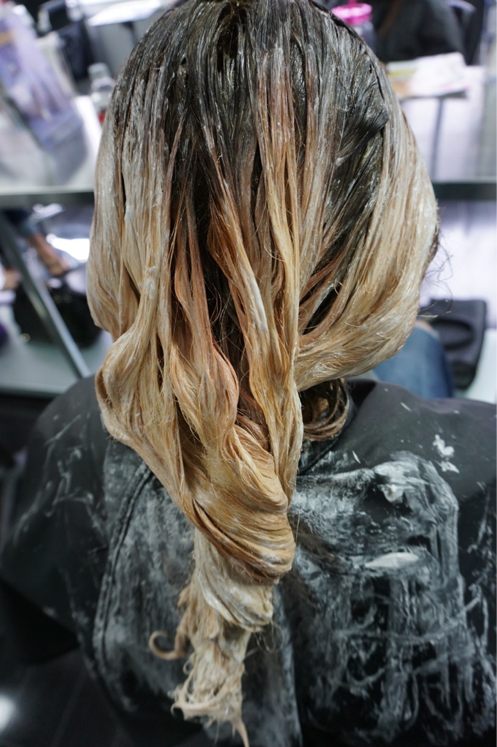 """Go over her lightened areas with a lower volume developer, to help kick out a previous blue color that was still in her hair. """"Personally, I like to twist the ends as a I feel it creates a small amount of heat and helps lift the ends.""""  Then color melt in the sink using: 3A 1/2 oz. + 3BV 1/2 oz. + 3V 1/2 oz. + 9BV 1 oz.  + Clear Shine 1/2 oz. - All PM Shines.  Dilute the solution to make it more of a level 6, to prevent base from getting too dark. Process for 7 minutes."""