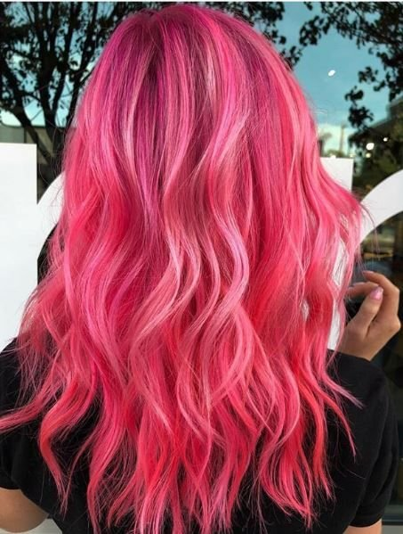 Hot pink can be difficult to pull off, but she does a great job of making this strong statement color still seem soft and pretty.