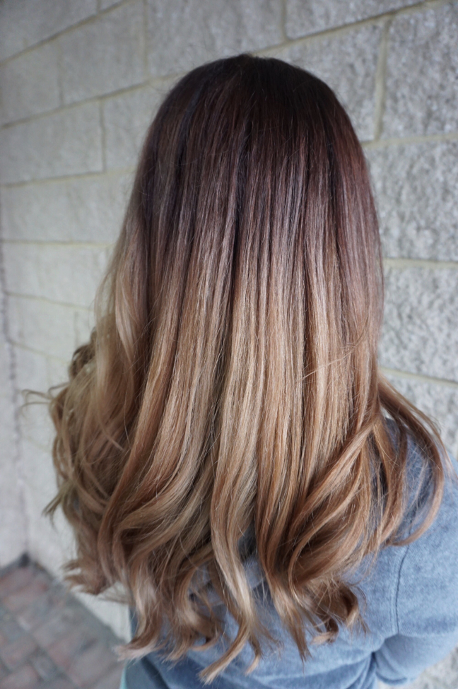 """The purple and silver tones in the formula help cool down and brass in her hair. Blow dry using Paul Mitchell Express Ion Round Brush XL. """"My guest was a new woman! She traded her unicorn hair for an effortless low maintenance style."""""""