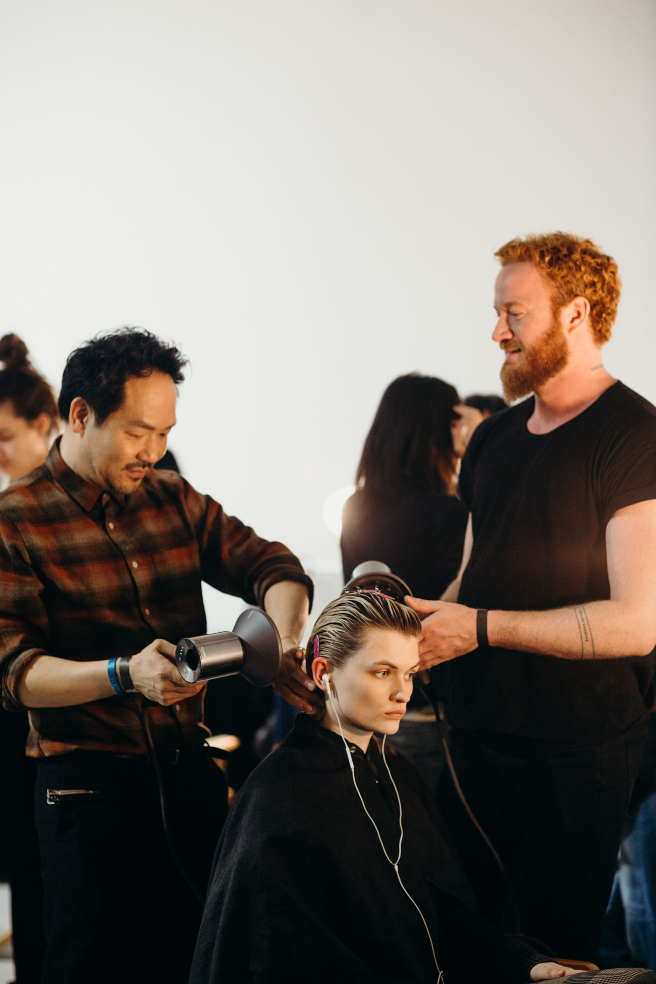Behind the scenes at Helmut Lang F/W 2019, sponsored by Oribe Hair Care and Dyson. Here Kien Hoang and Adam Livermore use Oribe Hair Care and a Dyson Supersonic Professional dryer to create a fresh silhouette.