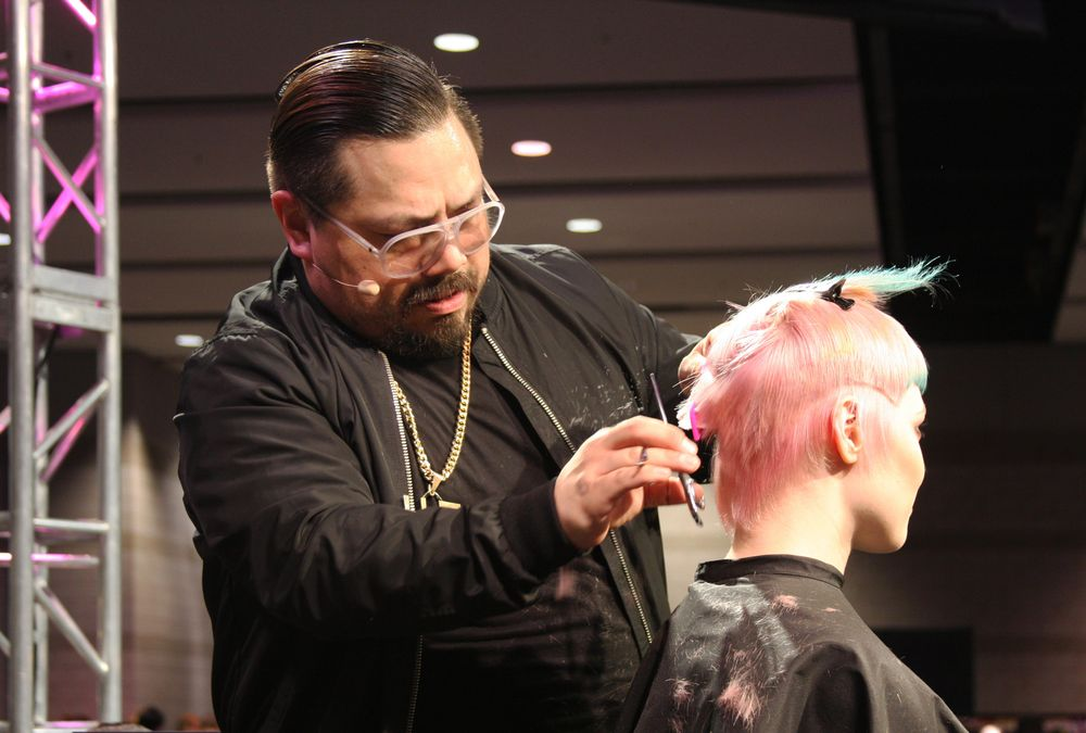 Hugo Urias shows off this hair cut during the Redken presentation at America's Beauty Show that features contrasting and gradient colors, and a strong fringe.