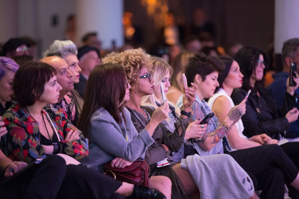 Attendees capture insights from Idealogue's speakers