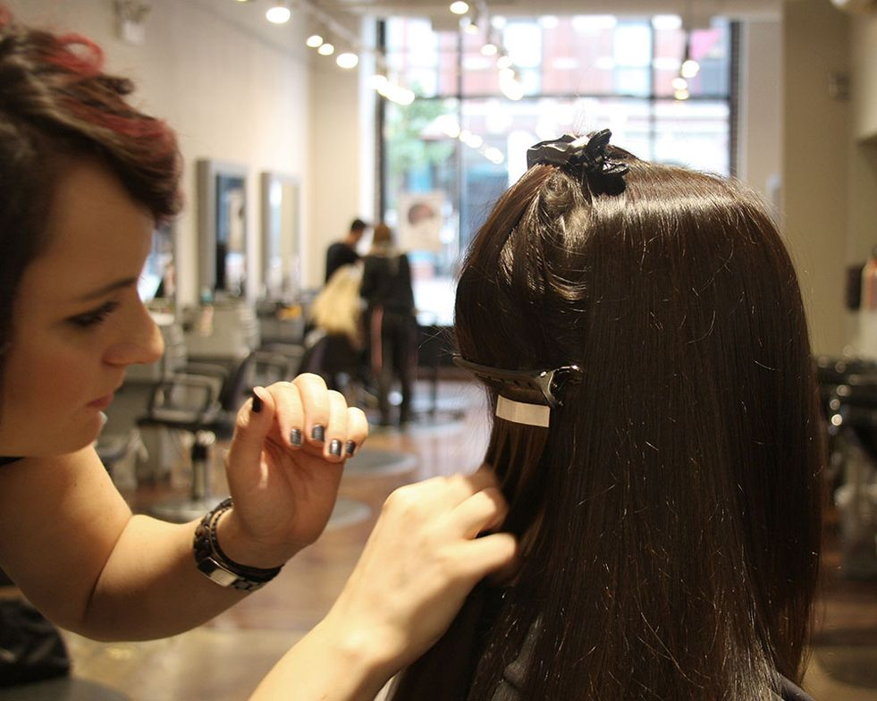Industrial Lengths Educator Kate Engelman applies Industrial Lengths Tape-in Hair Extensions to MODERN Web Editor Lauren Salapatek.