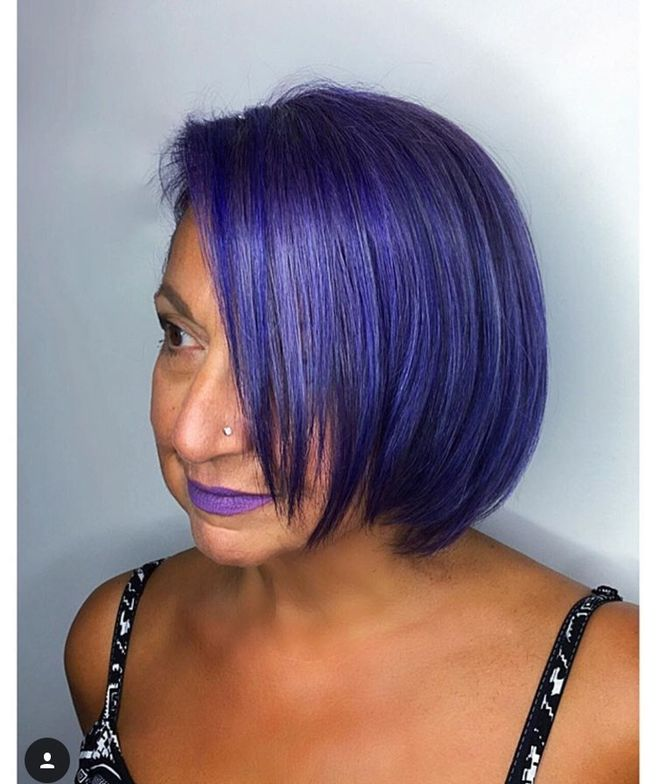 To add a little joy to her 66-year-old mother's life (pictured here,) colorist Holly DeCastri gave her rockin' purple locks! Bravo!!