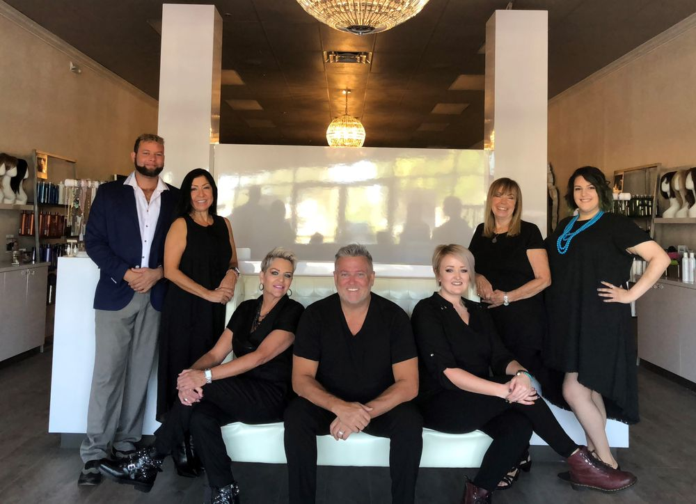 <p><strong>The team from Haus of Hair Naples has struggled for a year to recover from Hurricane Irma. Shown from left: Craig Locklear, customer service specialist; Elizabeth Seguira, stylist; Dawn Spencer, owner and stylist; John Spencer, owner and stylist; Yvonne Ming, stylist and manager; Linda Stein, stylist; Sarah Domonte, stylist and social media manager.</strong></p>