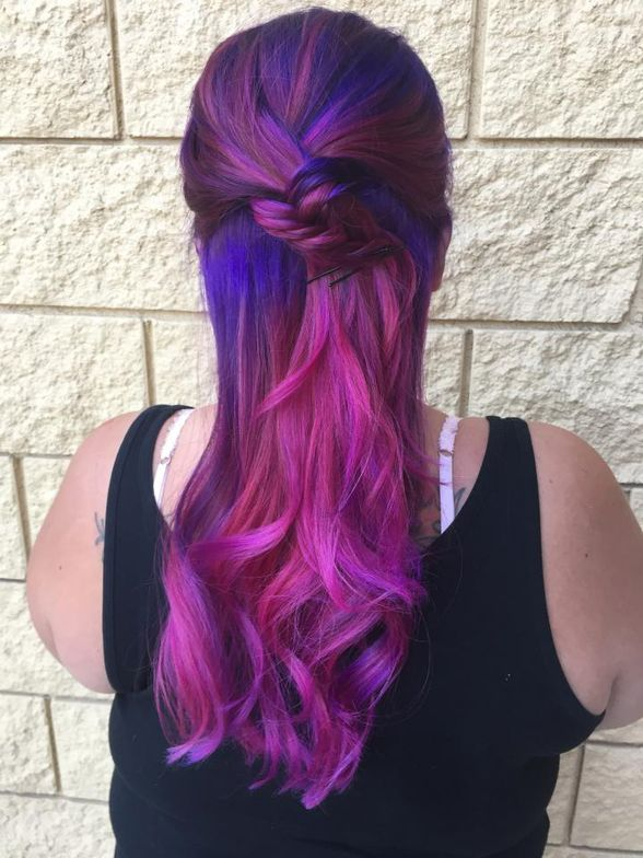 """""""My client came in with previously colored black hair into a faded pink ombré and faded blonde bangs. I color corrected her to a beautiful violet to pink ombre."""" -Shawna Musgrove"""