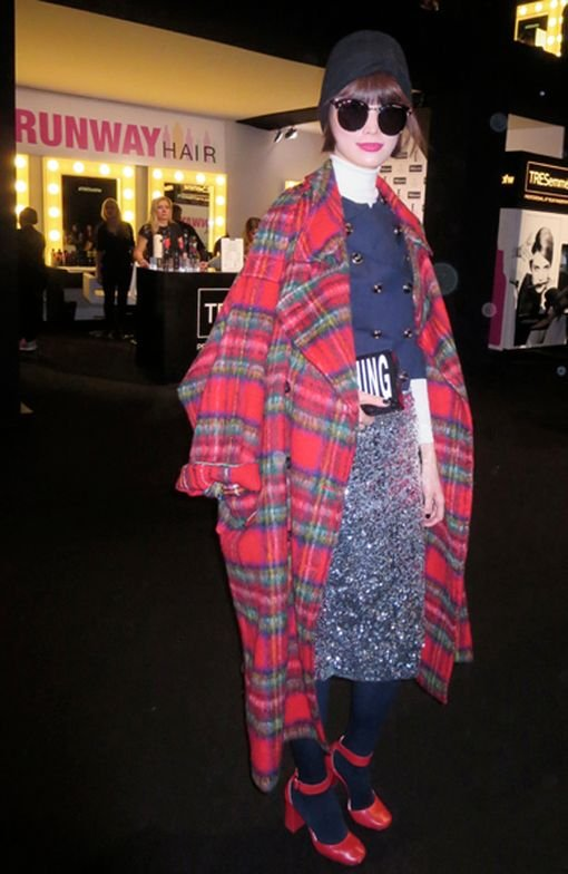 Song Kyang in her Pushbutton tartan coat, sliver skirt, big glasses, chic bob and red shoes, all looking terrific, photographed in the Lobby at Lincoln  Center during #MYFW for Fall 2015.