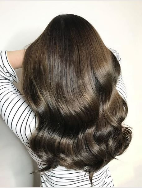 These bouncy brunette curls induce major hair envy.