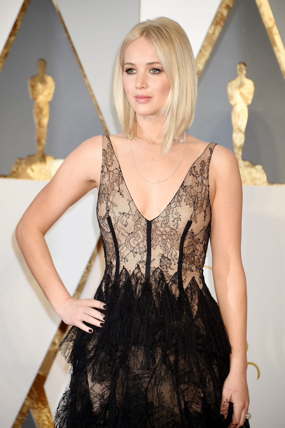 Jennifer Lawrence made a grand entrance this year with her pretty platinum haircolor, razor-cut lob and plunging V-neck sheer and lacey gown.