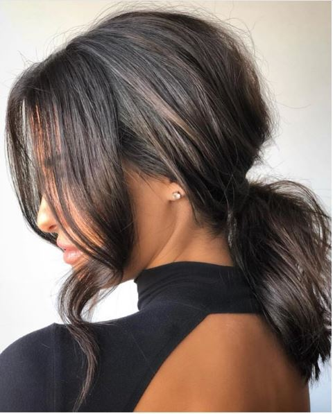 For clients with shorter lengths, ponytails can still be a great option, as shown here. The pony is still volumized, and the front pieces give the overall look more depth.