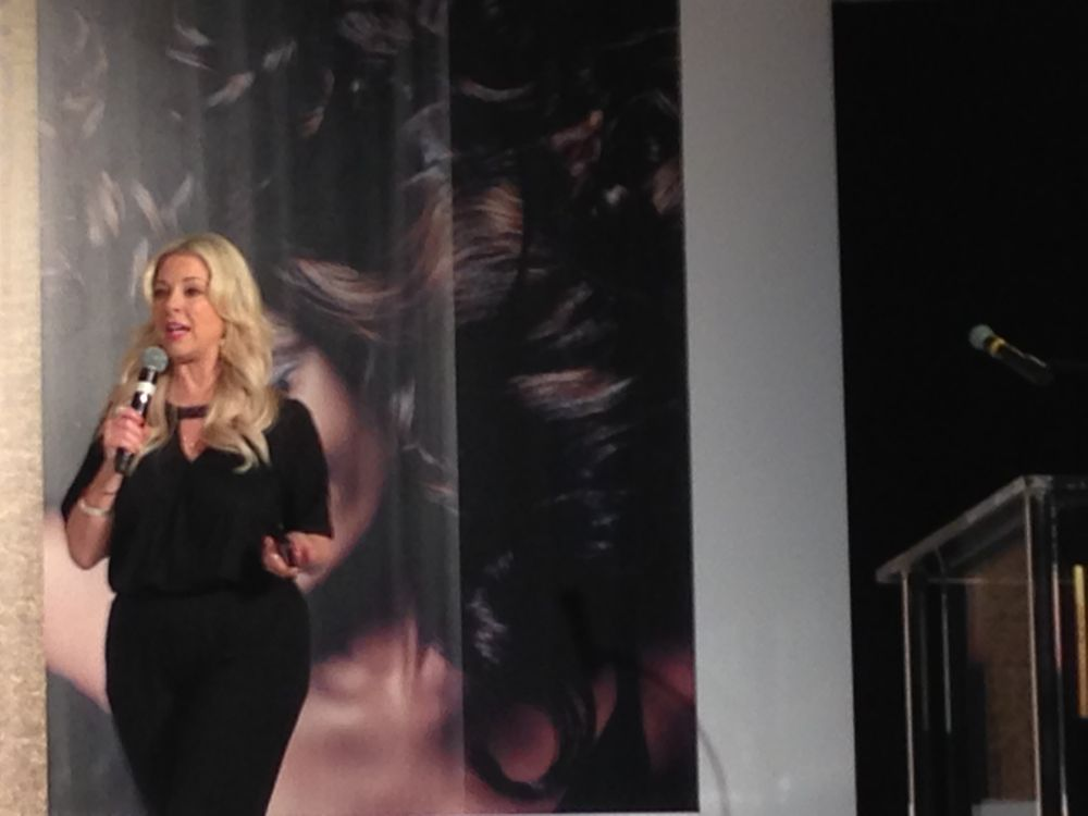 """Valerie Robinett, Director of PR at Joico, introduced several new initiatives including a new Joico Color System Mobile App. """"We included a color match feature, which is unique to Joico, because we wanted this to be a fun way to interact with clients."""""""